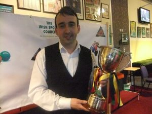 Martin McCrudden with the trophy after his 2014 success - photo courtesy of Ivy Rooms Carlow.