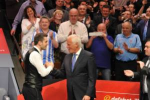 Hearn congratulating Mark Selby after last year's World Championship win - photo courtesy of Monique Limbos.