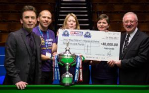 Ken Doherty and Dennis Taylor present the cheque to Jessie May