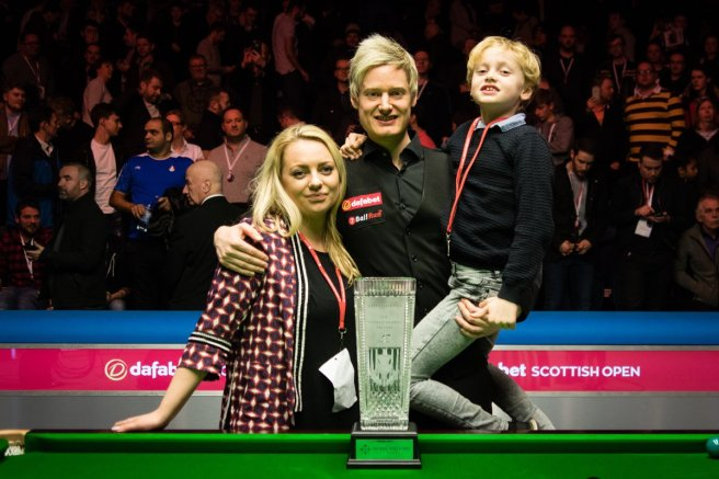A delighted Robertson with his family after receiving the Stephen Hendry Trophy. Photo credit: World Snooker